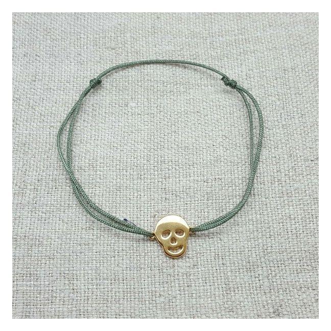 Bracelet tête de mort plaqué Or sur lien fin satiné